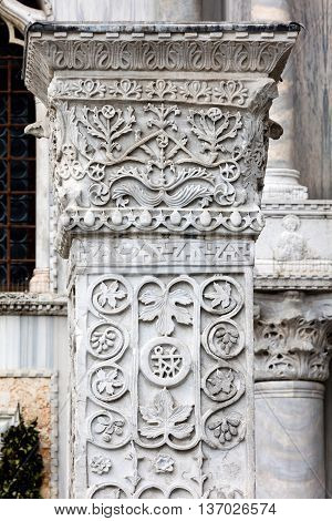 Medieval Gothic ornaments on a marble column near Doge Palace in Venice Italy