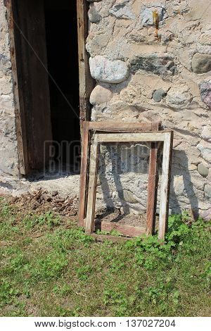 Old barn door stone wall with old windows