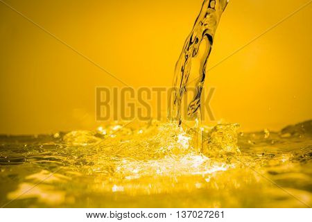 The effects of liquid, which has a golden color.