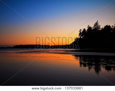 Glowing Orange Sunset over Beach with Reflection