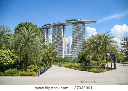 SINGAPORE - MAY 7 2016 : Marina Bay Sands Hotel building is a famous landmark of Singapore seen from Garden by the Bay.