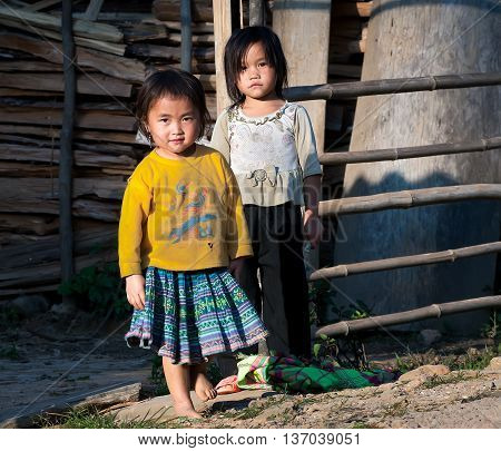 HA GIANG, VIET NAM, March 18, 2016 portrait of two children, ethnic Hmong, the high mountains of Ha Giang, Vietnam, together friendly