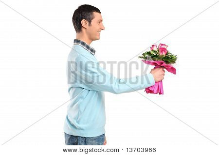 Young Smiling Man Giving Flowers