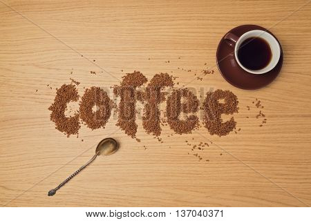 Coffee background with coffee cup and instant coffee. View from above