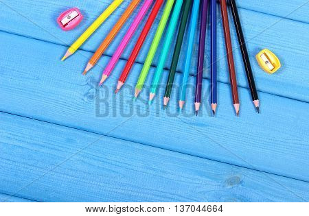 Colorful Crayons And Sharpener On Blue Boards, School Accessories, Copy Space For Text