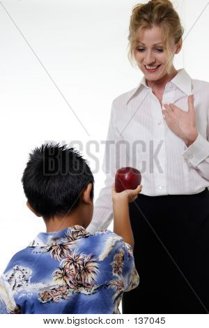 Kid Offering Apple To Teacher