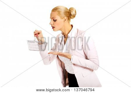 Smile business woman holding small shopping basket