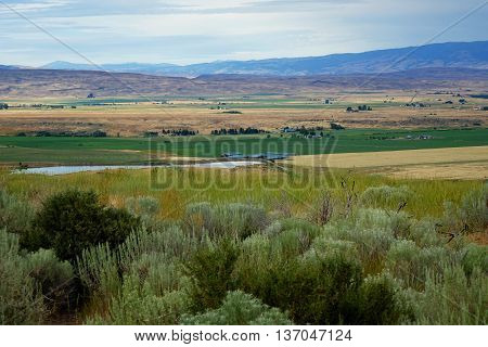 The farming community of Midvale, Idaho is viewed from a nearby sagebrush hill.
