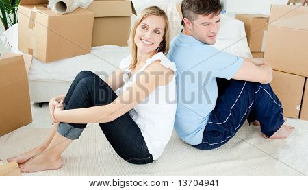 Young couple relaxing after moving in their new house