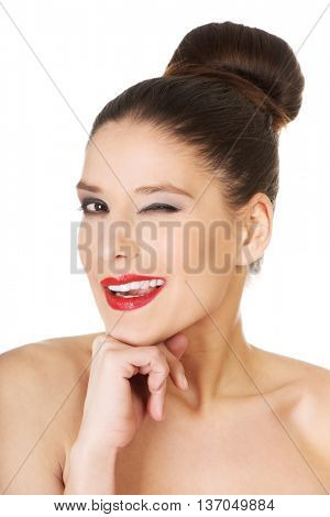 Beautiful woman with make up blinks eye.