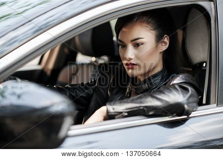 Portrait of woman driver waiting in traffic jams