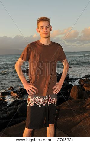 Single Young Teenage Man On The Beach
