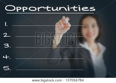 Beautiful businesswoman writing list of business weakness opportunities