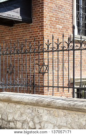 Star of David on metal fence of Old Synagogue in jewish district of Krakow - Kazimierz on Szeroka street in Poland