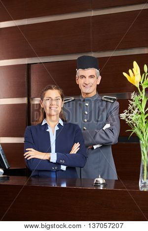 Concierge and receptionist as team at hotel reception