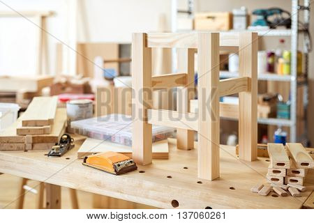 Stool making in woodworking workshop.