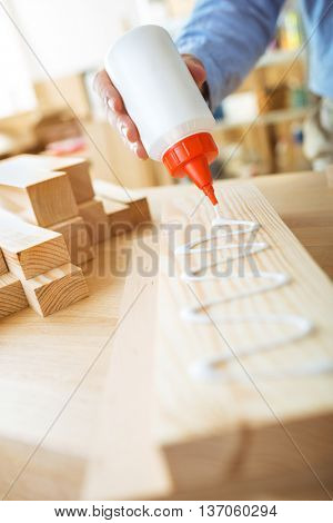 Gluing wooden board. DIY concept.