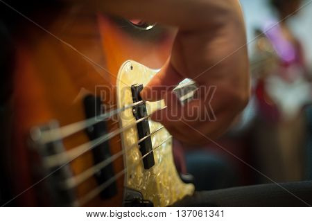Detail Of Man Playing Bass Instrument