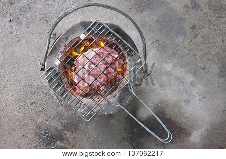 Brazier with hot charcoals ready for cooking
