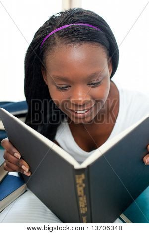 Concentrated woman reading a book with thumb up