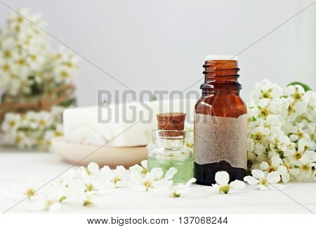 Facial aroma water in bottles, fresh spring cherry tree blossom. Pure cosmetics.