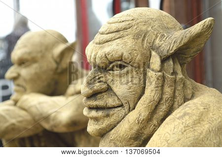 Closeup of carved gargoyle with big ears