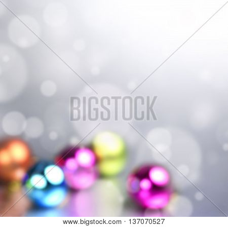 defocused christmas background with snow flakes and christmas tree balls. Copy space.