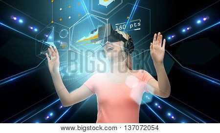 technology, virtual reality, cyberspace and people concept - happy young woman with virtual reality headset or 3d glasses looking at charts on screen projection over black background and lights