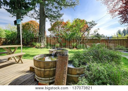 Fenced Back Yard With Patio Area And Beautifully Designed Pond