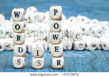 Stack of Words is power dice puzzle on wood background Inspiration concept .
