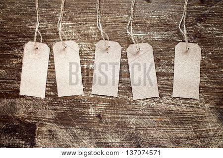 blank tags on the wooden background with copy-space