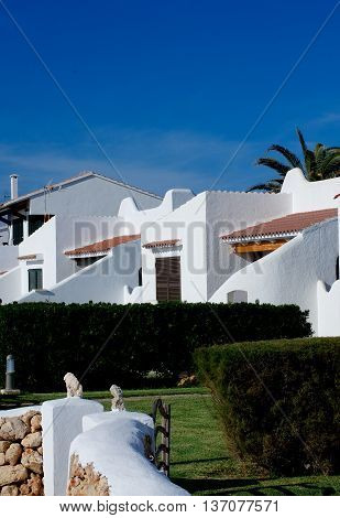 Traditional Country Holiday Houses in Sunny Day on Blue Sky background Outdoors. Balearic Islands Menorca
