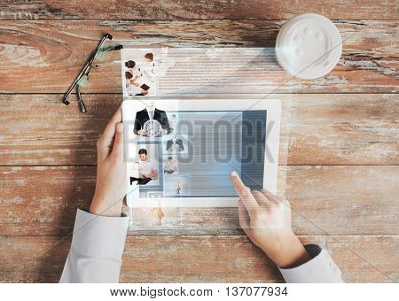 business, people, social network and technology concept - close up of hands pointing finger to tablet pc computer screen with internet article, coffee cup and eyeglasses on table