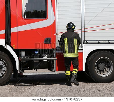 Brave Firefighter With Fire Engine Truck On The Road