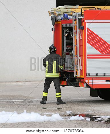 Fireman In Uniform Fire Prevention And Fire Truck