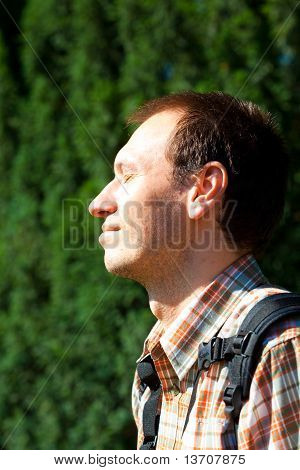 Man On A Background Of Green Foliage