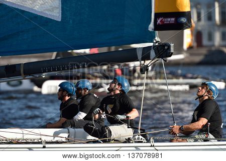 ST. PETERSBURG, RUSSIA - AUGUST 23, 2015: Catamaran of Oman Air sailing team during last day of St. Petersburg stage of Extreme Sailing Series. The Wave, Muscat team of Oman leading after 3 days