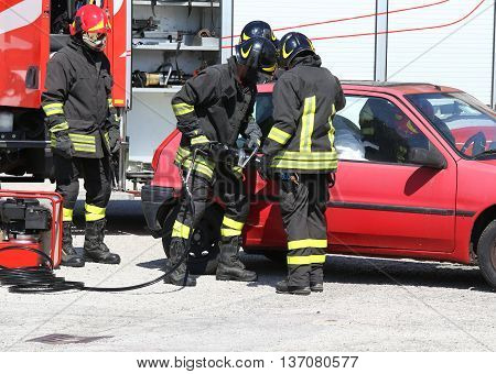 Firefighter Opens Car Door With Pneumatic Shears