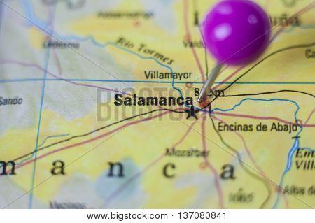 Pushpin marking on Salamanca Spain. Selective focus on city