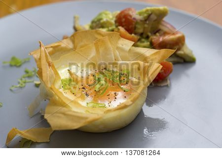 Egg Blossoms Baked egg in filo pastry with avocado salsa