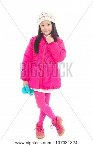 Beautiul asian girl in colorful winter clothes on white background isolated