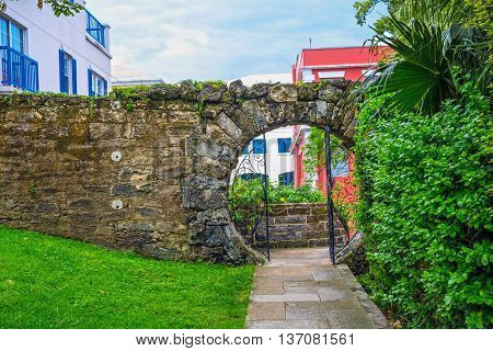 An old stone wall with a moon gate in Queens Park Hamilton Bermuda.