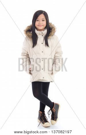 Beautiful asian girl in winter coat on white background isolated