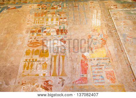 Ancient hieroglyphs on wall