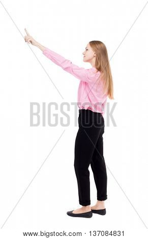 Back view of  pointing woman. beautiful girl. Rear view people collection.  backside view of person.  Isolated over white background. Smiling girl standing with cancer and shows thumb.