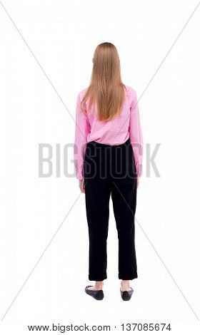 back view of standing young beautiful  woman.  girl  watching. Rear view people collection.  backside view of person.  Office worker girl standing with her hands along the body.