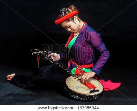 HA NOI, VIET NAM, April 14, 2016 maiden Ha Noi, traditional costumes, playing stringed instruments, called NGUYET CAM