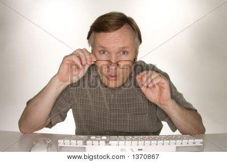 Shocked Man Viewing Computer Screen