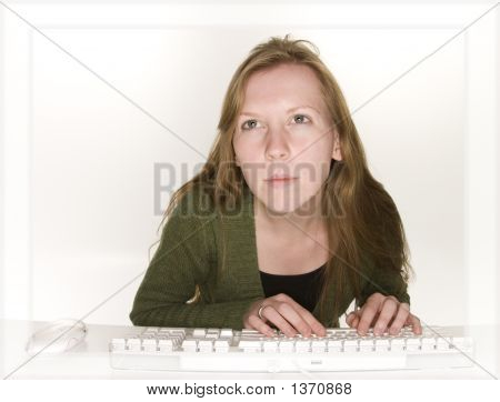 Studious Woman Viewing Computer Monitor