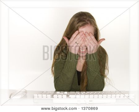 Surprised Woman Hiding From Computer Monitor